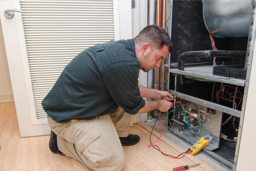 technician repairing short cycling furnace